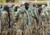Kolombiyalı paramiliterler gruplar Kolombiya'daki şiddettin büyük bir parçasıdır ancak mevcut barış görüşmelerine dahil değillerdir. | Fotoğraf: EFE