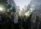 6 Temmuz'da Rio de Janeiro'da Olimpiyatlara karşı düzenlenen gösteriden bir kare. Fotoğraf: Silvia Izquierdo / AP